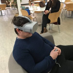 Image of a man using a haptic oculus rift