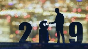 Image of 2019 in figures with robot and man