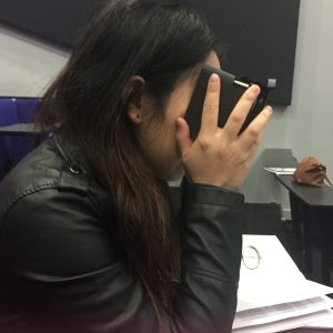 female chinese student with google cardboard