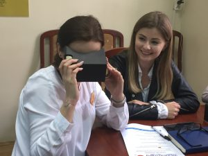 two female students one with Google cardboard