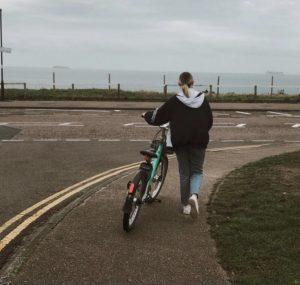 Tia pushing a Beyrl bike