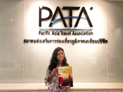 "A picture of me at PATA's HQ in Bangkok with the published report ""Travel & Tourism- A Force for Good in the World'."